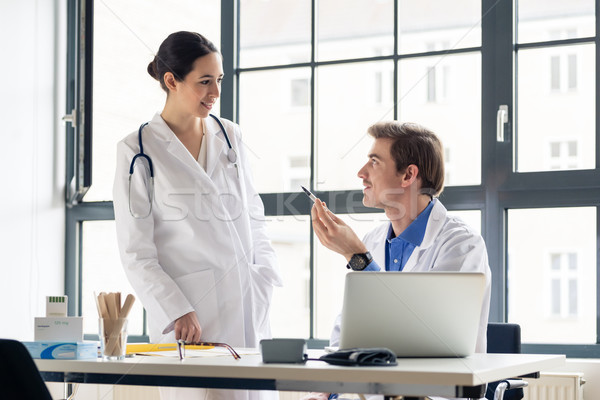 Young female physician asking for advice from her experienced colleague Stock photo © Kzenon