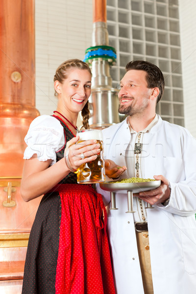 brewer and woman with beer glass in brewery Stock photo © Kzenon