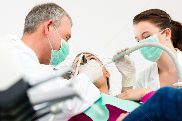 Patient with Dentist - dental treatment Stock photo © Kzenon