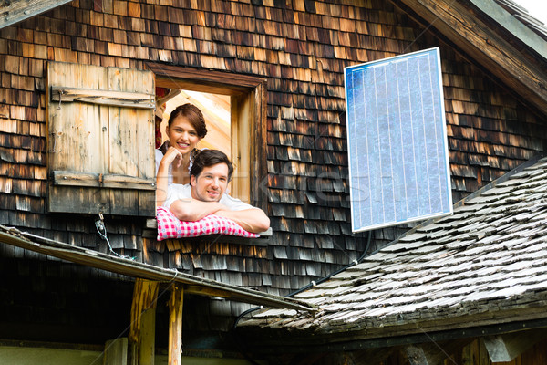 couple with bed clothes in mountain cabin Stock photo © Kzenon