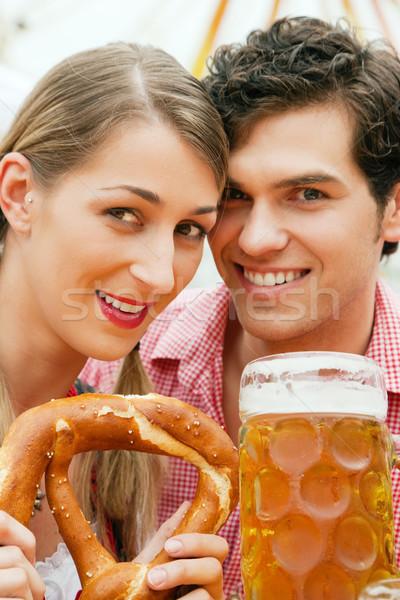Couple in a beer tent Stock photo © Kzenon