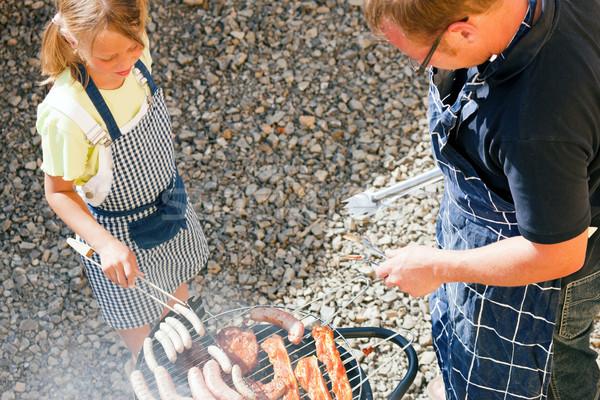 Dad and kid doing the BBQ Stock photo © Kzenon