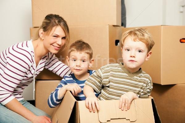 Family moving in their new home Stock photo © Kzenon
