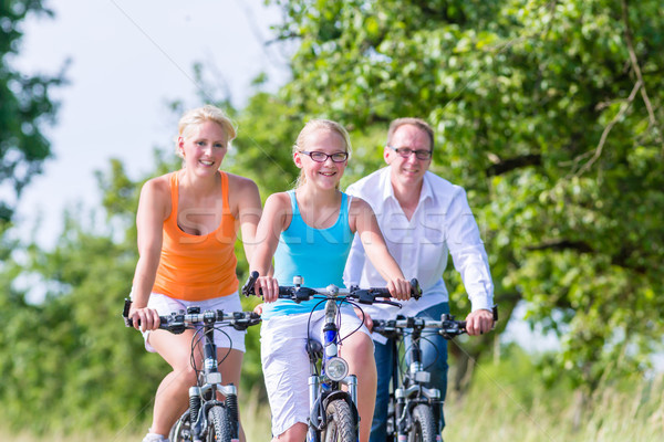 Stock photo: Family having weekend bicycle tour outdoors