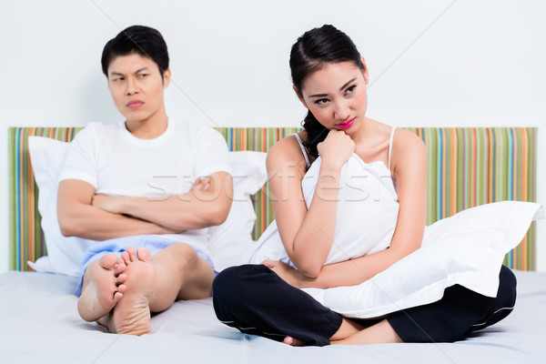 Alienated Chinese couple, woman is rejecting her man Stock photo © Kzenon
