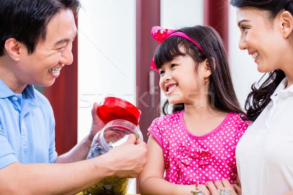 Chinese family saving money for college fund Stock photo © Kzenon