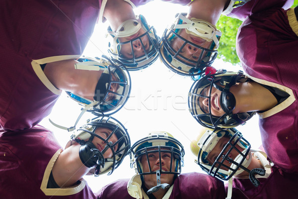 American Football Team having huddle in match Stock photo © Kzenon