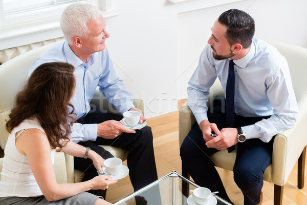 Financial advisor consulting couple in retirement planning Stock photo © Kzenon