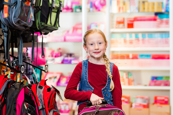 Child choosing school satchel in store Stock photo © Kzenon