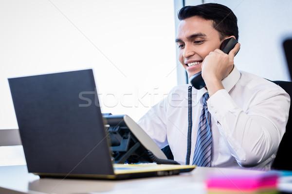 Salesman in office making phone call Stock photo © Kzenon