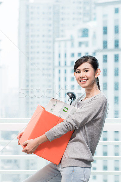Young asian girl carrying removal crate Stock photo © Kzenon