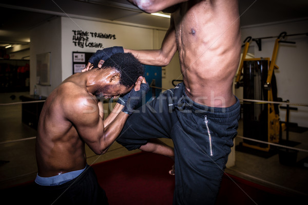 Agile fighter in defensive stance protecting his face from hit d Stock photo © Kzenon