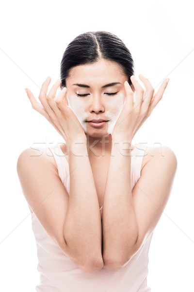 Woman applying facial moisturizer cream for sensitive skin Stock photo © Kzenon