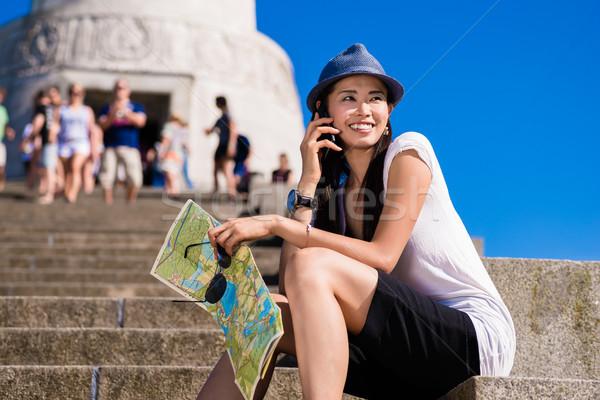 Asian female tourist smiling  outdoors Stock photo © Kzenon