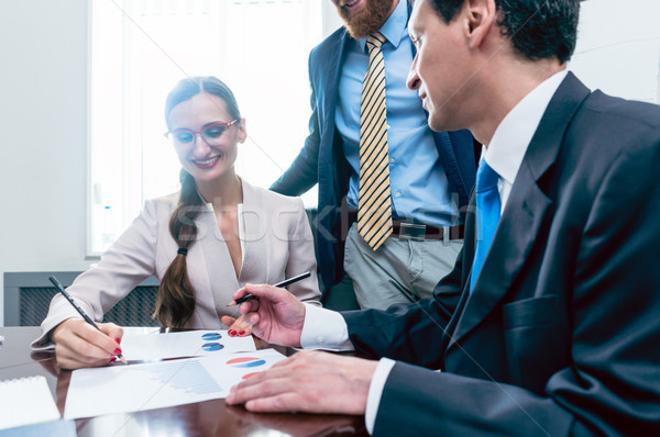 Business analyst smiling while interpreting financial reports Stock photo © Kzenon