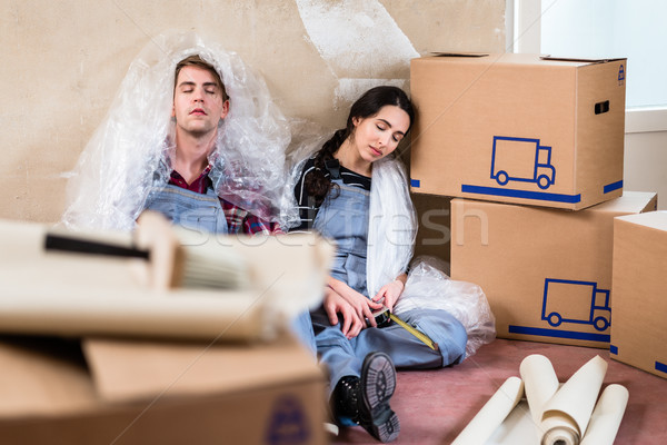 Young couple day dreaming about their future after moving in Stock photo © Kzenon