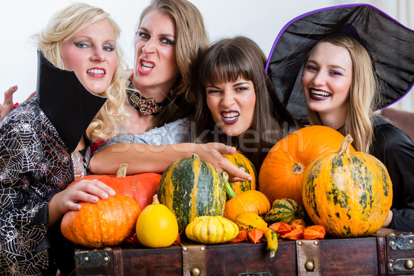 Quatro alegre mulheres halloween juntos Foto stock © Kzenon