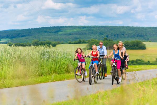 Family cycling in summer in rural landscape Stock photo © Kzenon