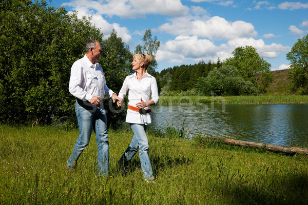 Senior Couple at a lake in summer Stock photo © Kzenon