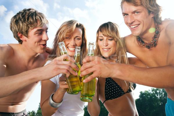 четыре человека пляж вечеринка группа четыре Сток-фото © Kzenon
