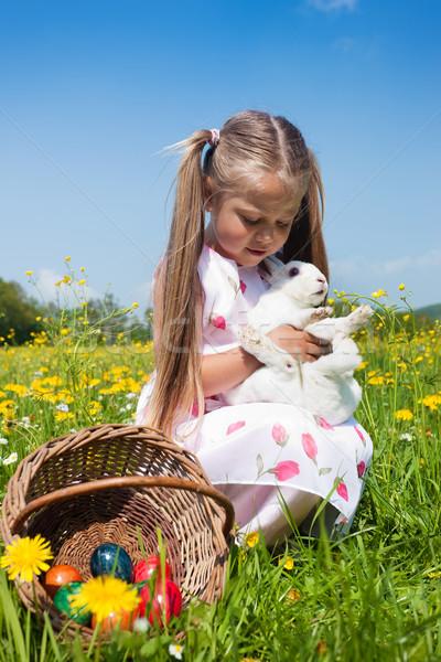 girl hugging the eastern bunny Stock photo © Kzenon