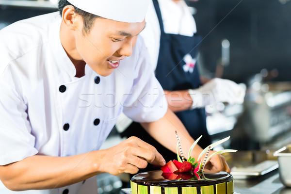 азиатских Повара приготовления ресторан молодые Сток-фото © Kzenon