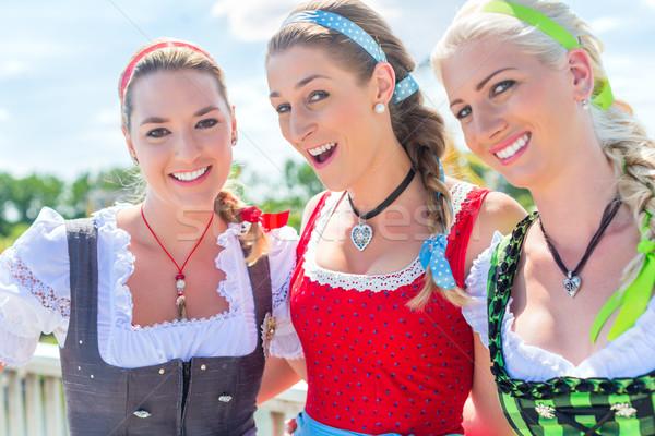 Friends visiting Bavarian fair having fun Stock photo © Kzenon