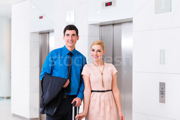 Man and woman arriving at hotel lobby with suitcase  Stock photo © Kzenon
