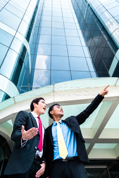 Asian businesspeople in front of high rise building  Stock photo © Kzenon