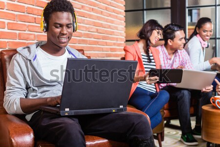 Computer programmer in start-up company coding Stock photo © Kzenon