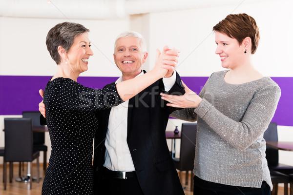 Dance instructor with senior couple Stock photo © Kzenon