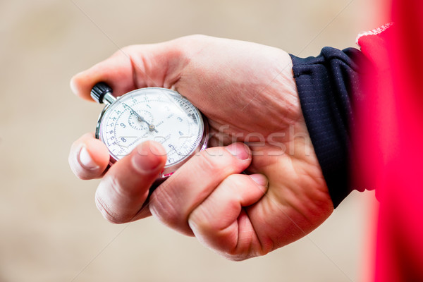 Man taking running time with stop watch  Stock photo © Kzenon