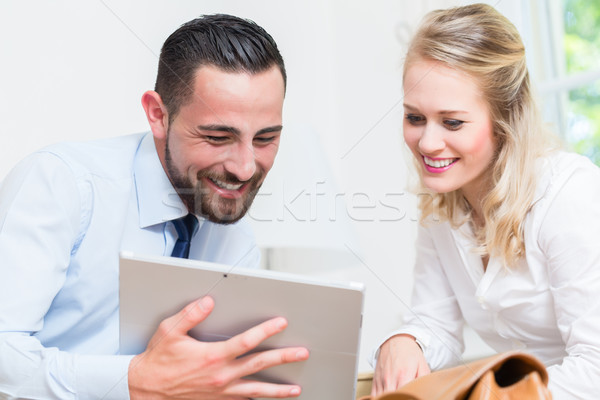 Business woman and man in work meeting Stock photo © Kzenon