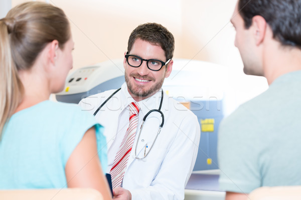 Pregnant woman and her partner seeing physician Stock photo © Kzenon