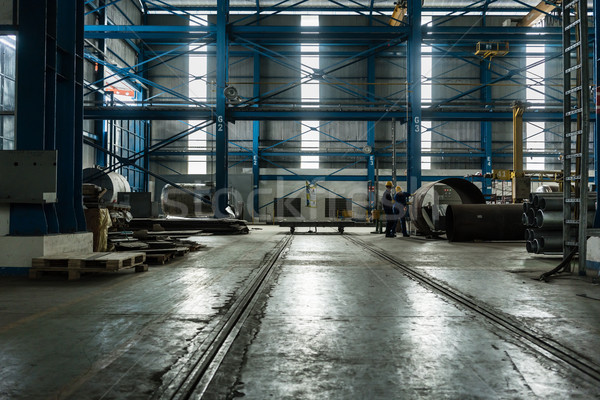 Two workers planning manufacturing process Stock photo © Kzenon