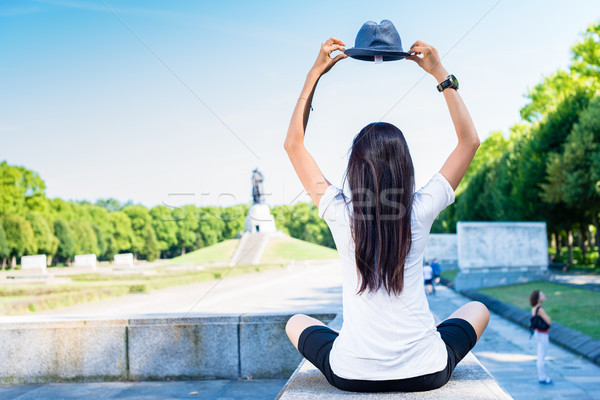 Woman holding a blue hat above the head Stock photo © Kzenon