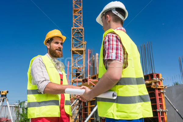 Cheerful worker shaking the hand of an architect Stock photo © Kzenon