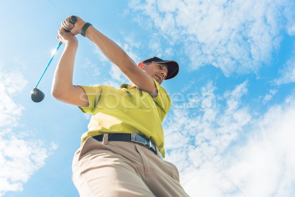 Low-angle view of a professional player holding the club during individual game Stock photo © Kzenon