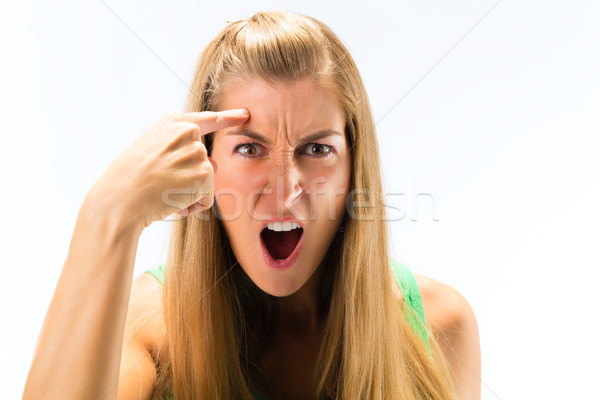 Stock photo: An angry young woman shouting