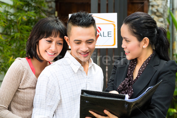 Asian couple looking for real estate Stock photo © Kzenon