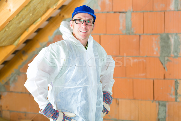 Worker attaching thermal insulation to roof Stock photo © Kzenon