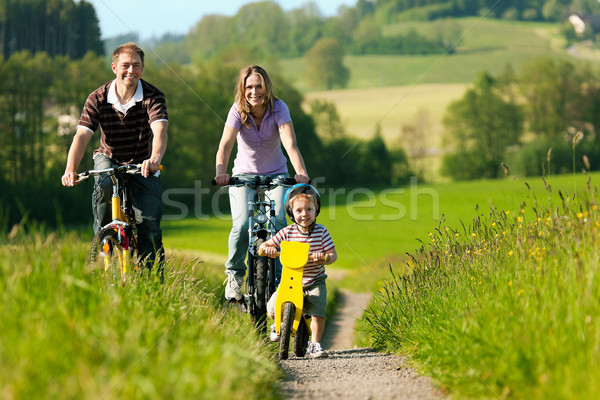 Family riding bicycles in summer Stock photo © Kzenon