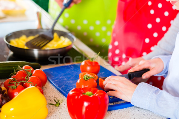 Family cooking in domestic kitchen healthy food Stock photo © Kzenon