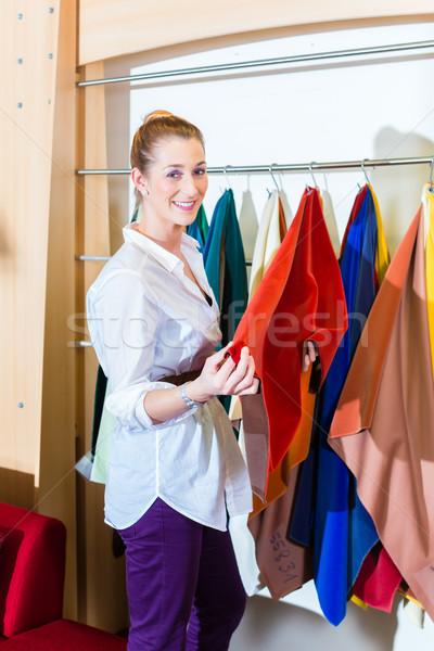 Woman picking seat cover in furniture store Stock photo © Kzenon