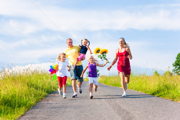Family running down hill in summer Stock photo © Kzenon
