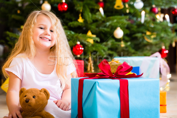 Girl with present and teddy on Christmas day Stock photo © Kzenon