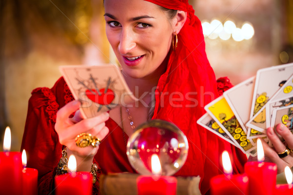 Soothsayer in Seance or session with tarot cards Stock photo © Kzenon