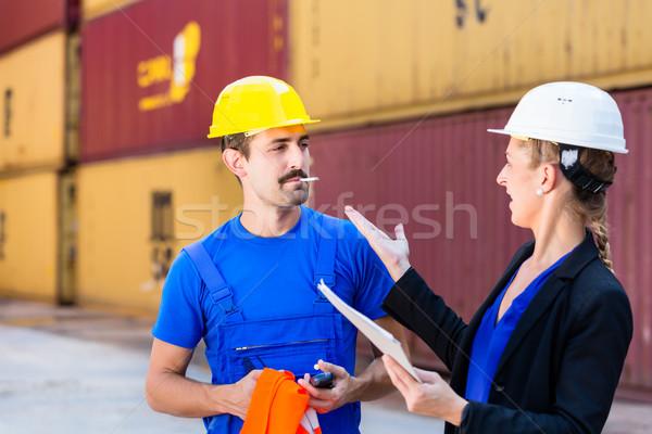 Smoking employee in port or container terminal Stock photo © Kzenon