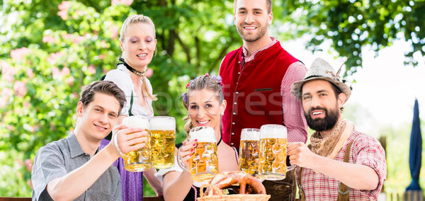 Friends in Bavarian beer garden drinking in summer Stock photo © Kzenon