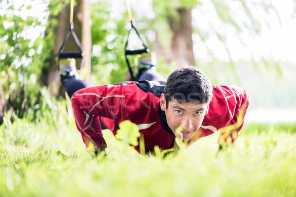 Férfi fitnessz csúzli boldog sport nyár Stock fotó © Kzenon
